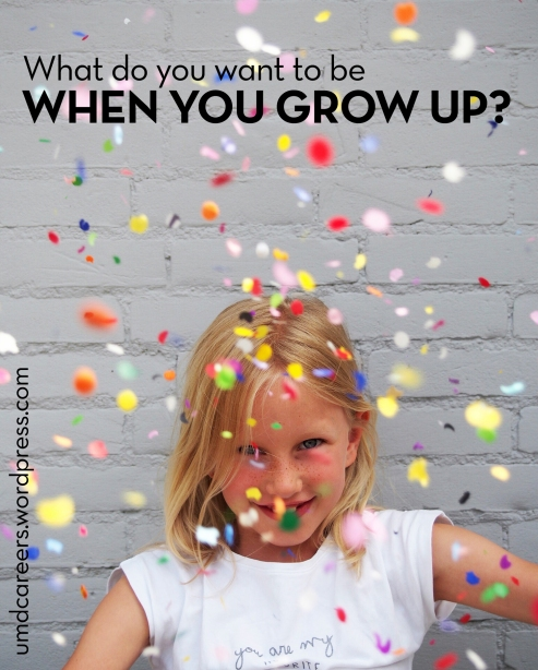 What do you want to be when you grow up? Young Caucasian female with confetti.