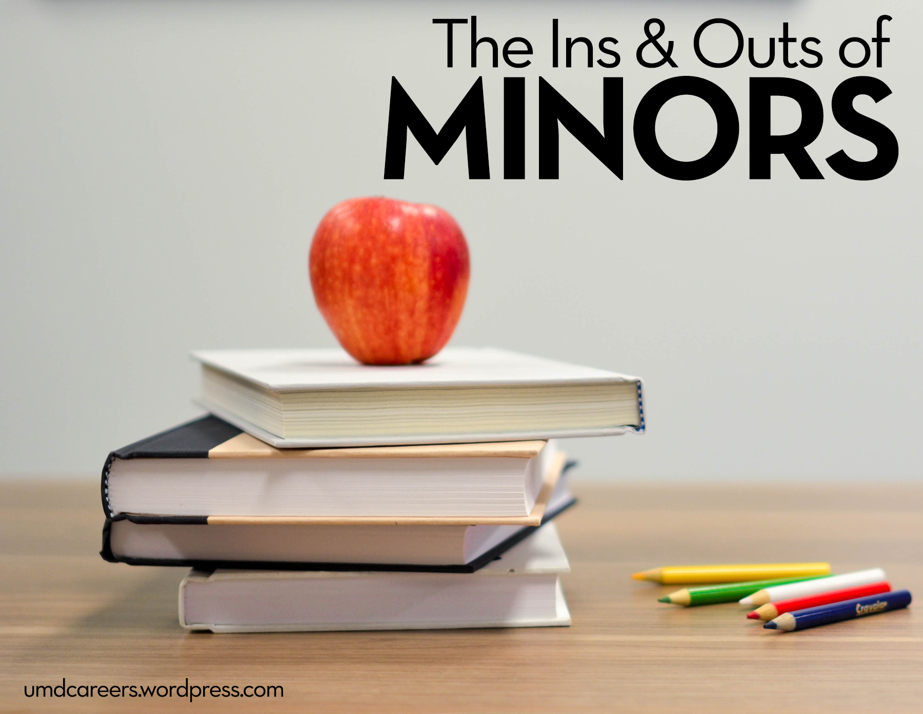 The Ins and outs of minors. photo of book pile with apple