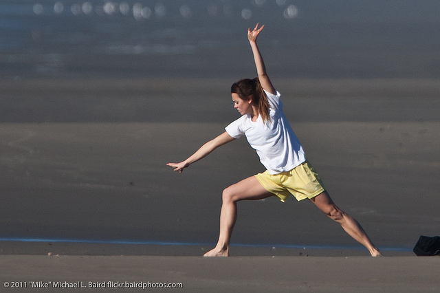 Girl doing exercises on Morro Strand State Beach