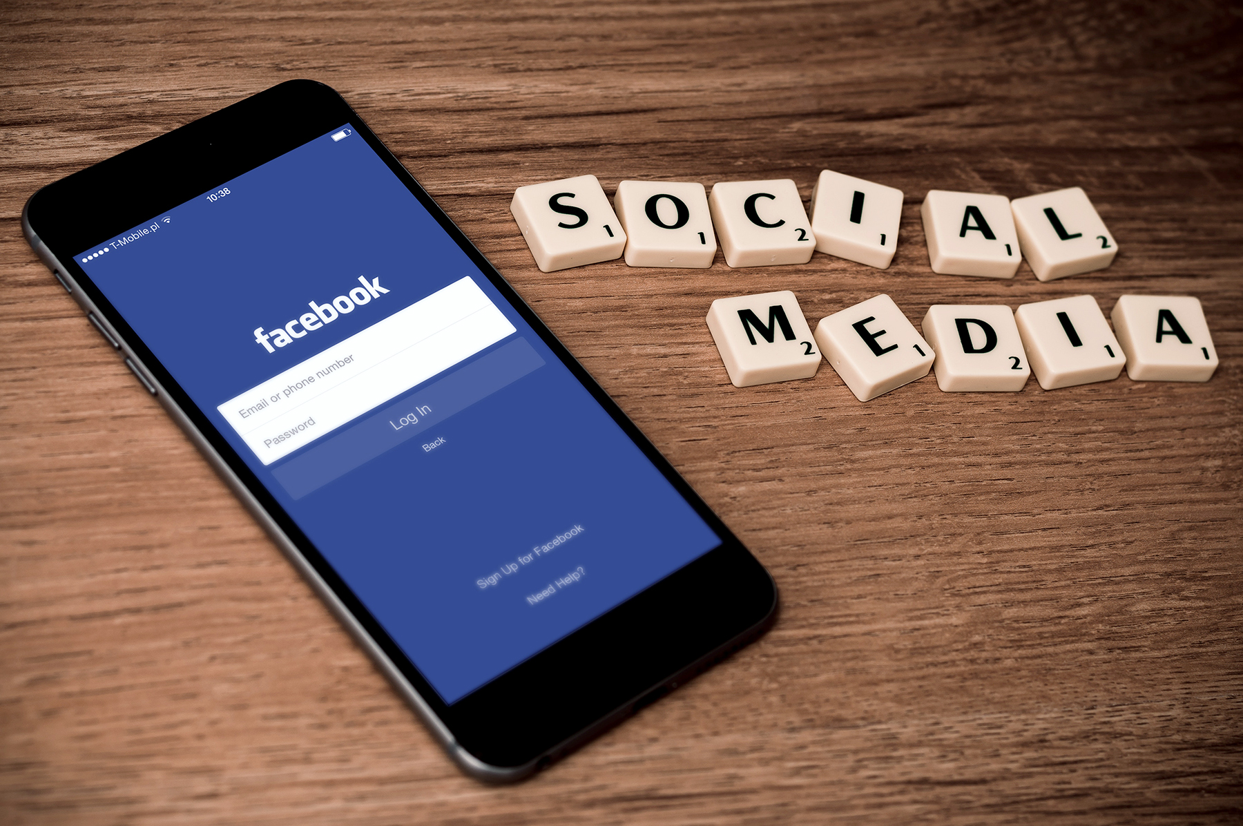 Social media, mobile Facebook app on phone