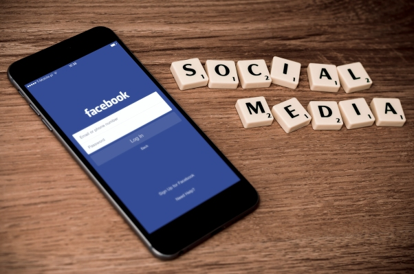 Social media, mobile Facebook app on phone