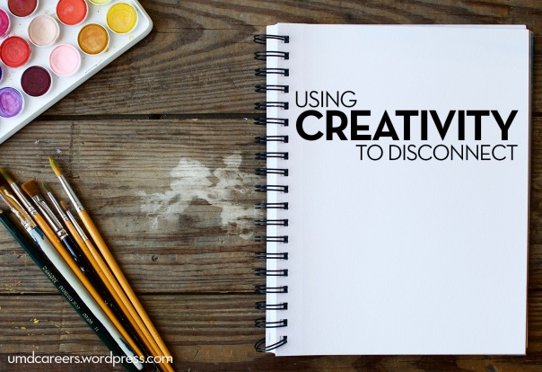 Using creativity to disconnect - sketchbook on desk with watercolors