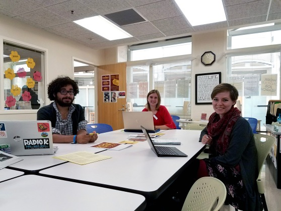 3 students sitting at table