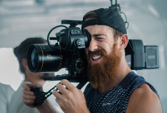 caucasian male holding video camera on shoulder