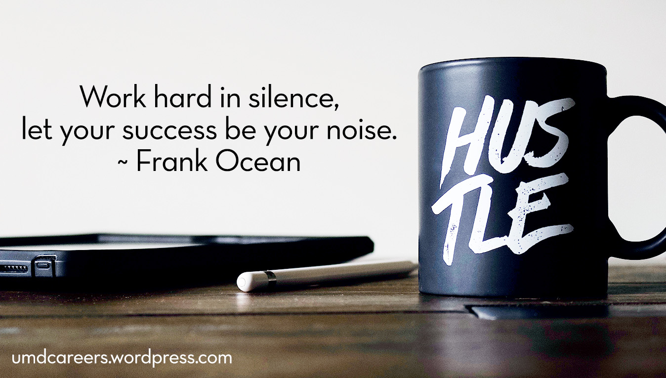 "desktop with electronic device and black coffee cup with ""hustle"" on it; quote: work hard in silence, let your success be your noise. by Frank Ocean"