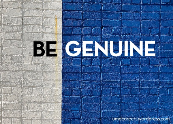 Image: brick wall painted white on left side and blue on right side Text: Be Genuine