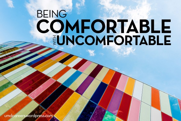 Image: looking at the blue sky up the side of colorful building  Text: being comfortable with uncomfortable