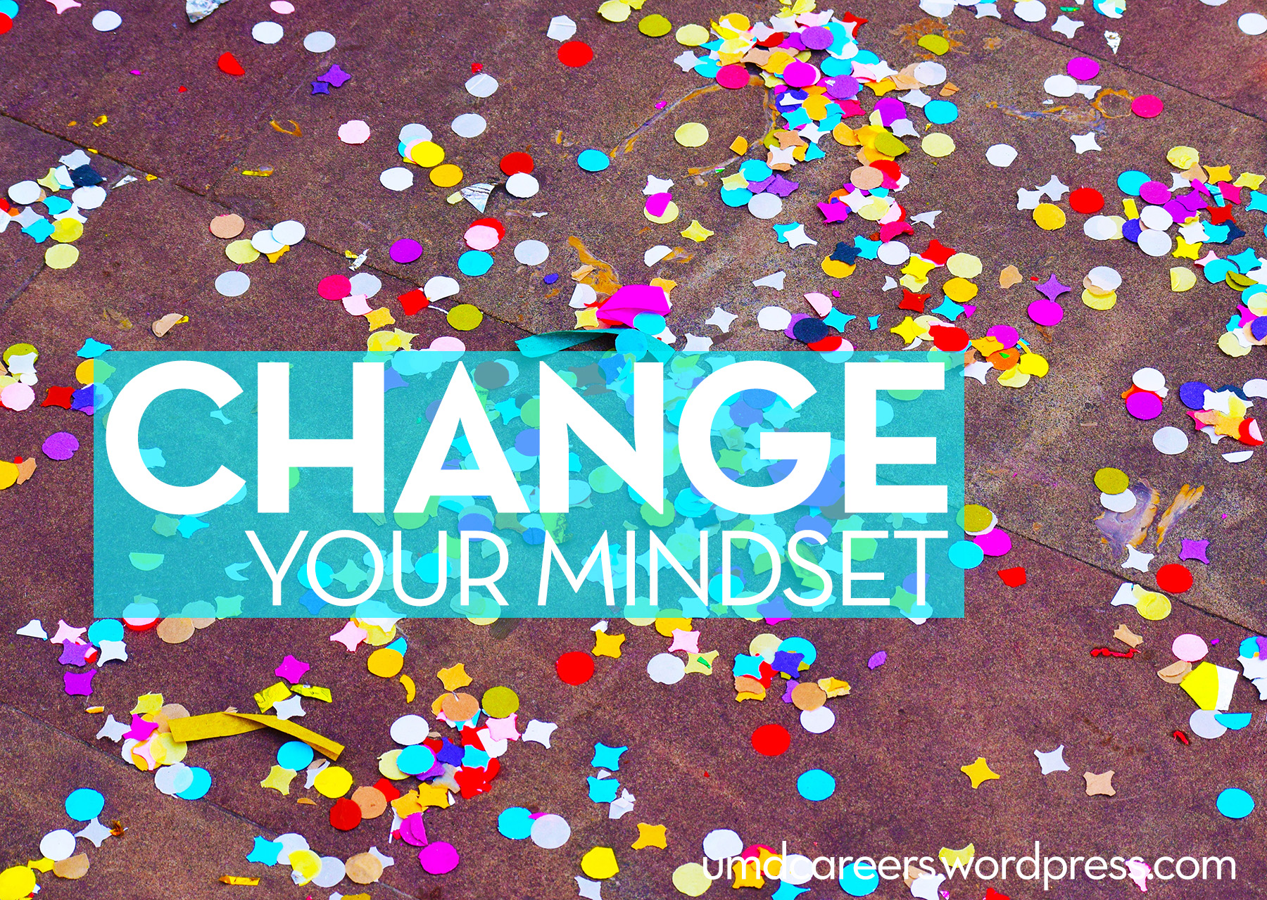 Image: colored confetti on brown stone background Text: Change your Mindset