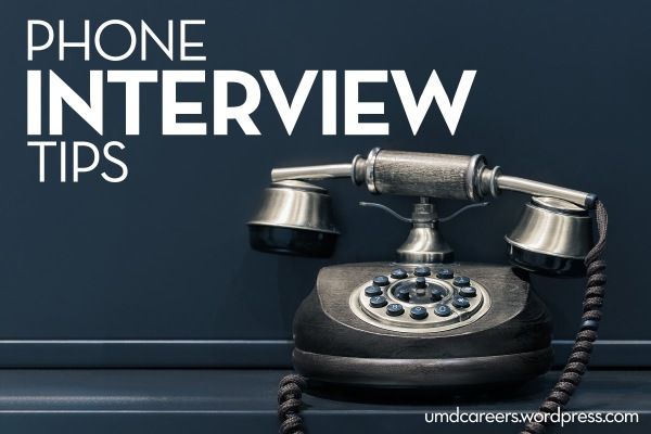 Image: black and silver table rotary phone Text: Phone interview tips