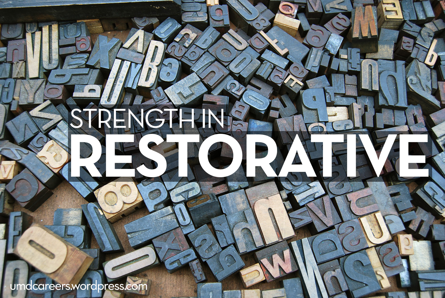 Image: block letters Text: Strength in Restorative