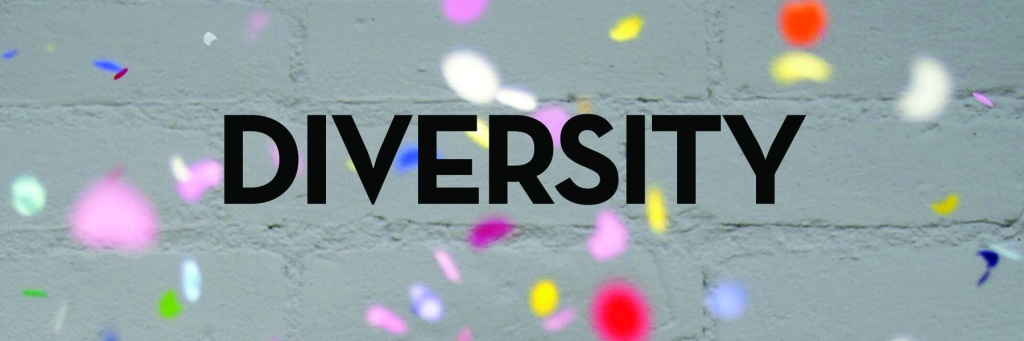 Image: colored confetti with white brick in background Text: diversity