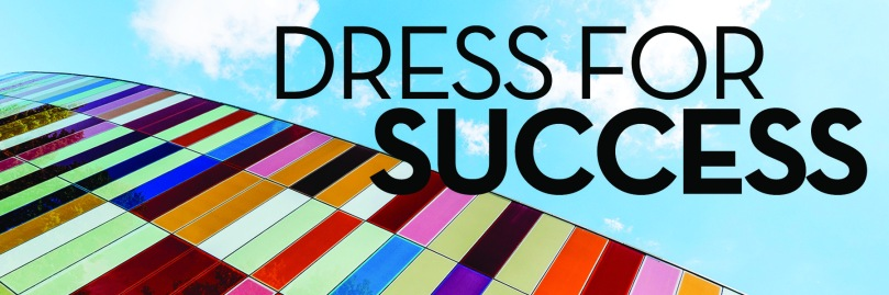 Image: looking up at colorful building and sky Text: dress for success