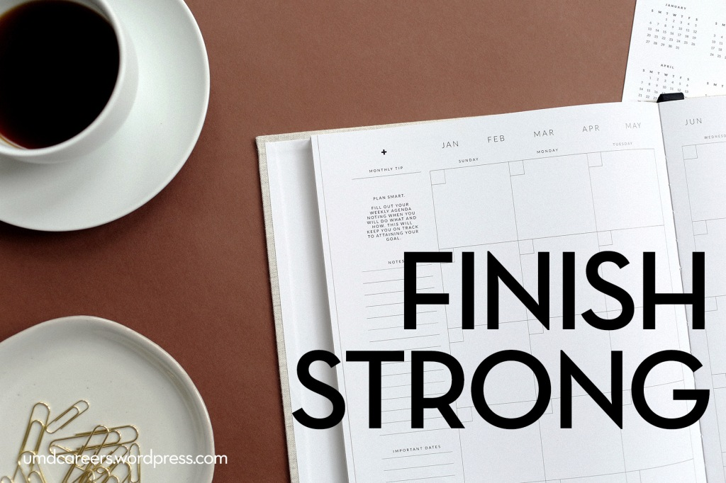 Image: desktop with open paper planner, coffee cup, and dish of paperclips Text: Finish strong
