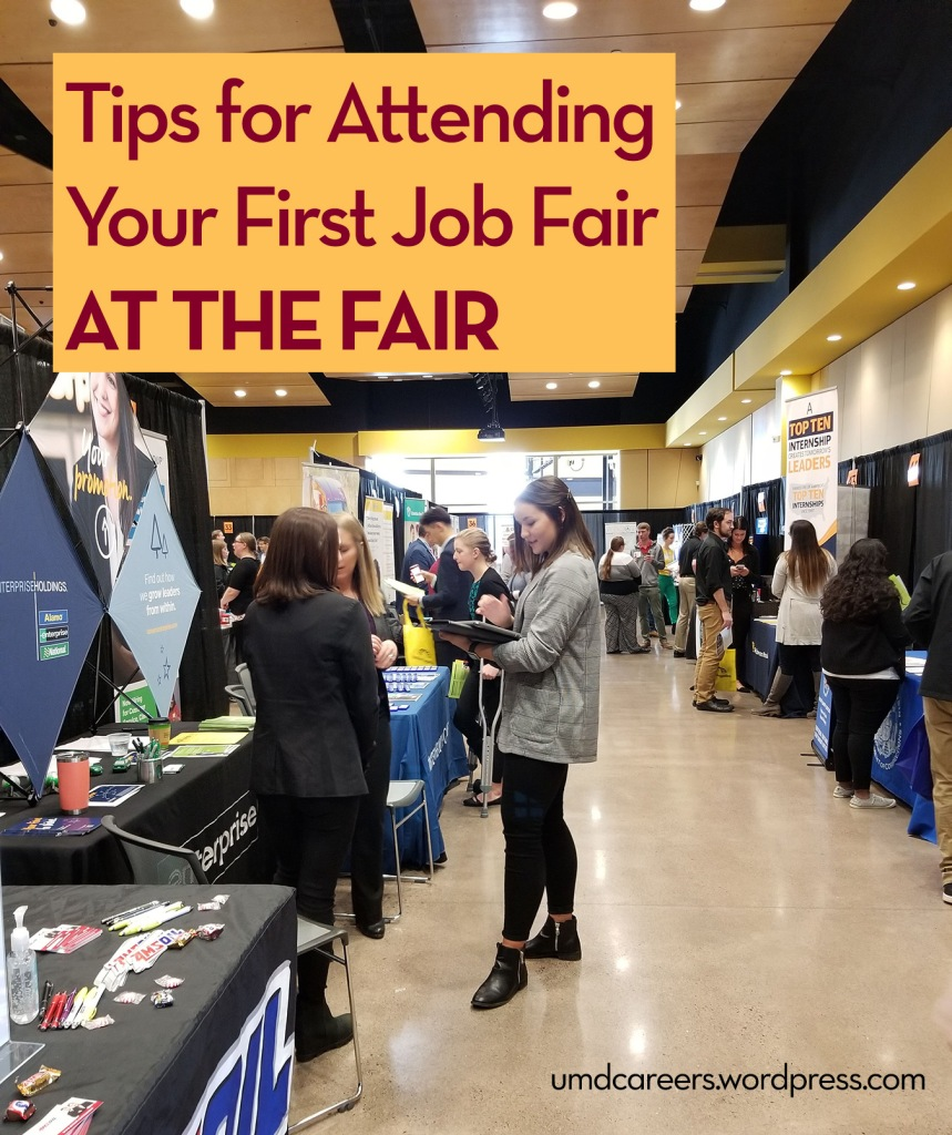 Image: young woman in suit jacket talking to people Text: Tips for attending your first job fair - at the fair