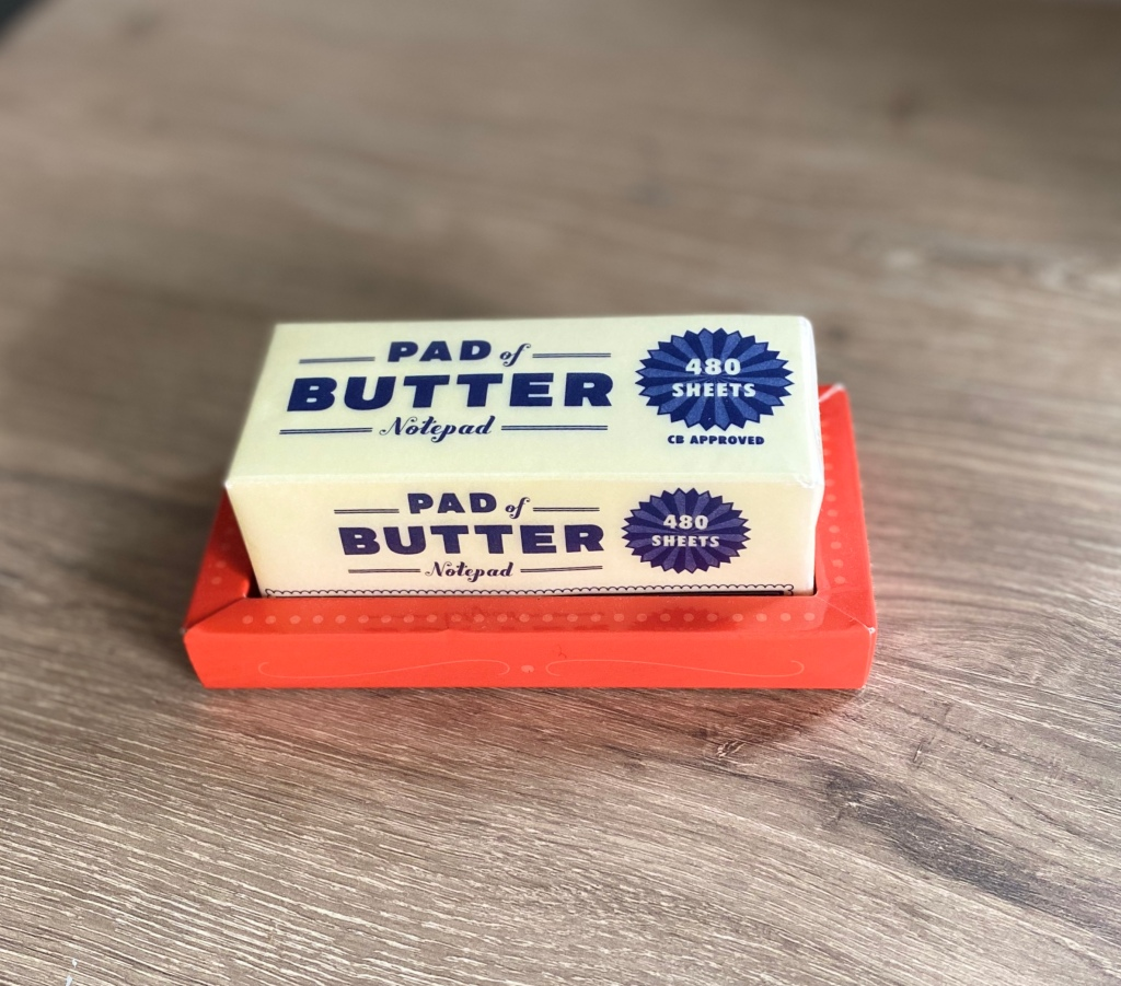notepad in the shape of a stick of butter on a dish